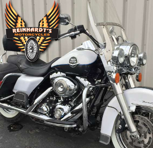 Photo of a harley cruiser parked with Reinhardts logo