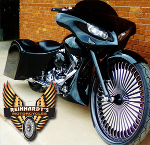 Photo of a Harley Davidson Bagger with custom front tire with Reinhardt's Motorcycle logo