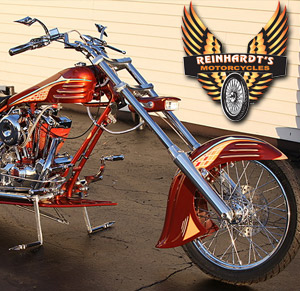 Photo of a Custom Harley with custom front motorcycle tire with Reinhardt's Motorcycle logo