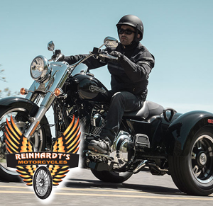 Photo of a Harley Trike with kit on and Reinhardts logo