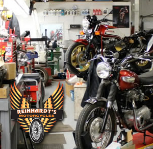 Photo of a multiple motorcycles on mechanic stands with Reinhardt's logo